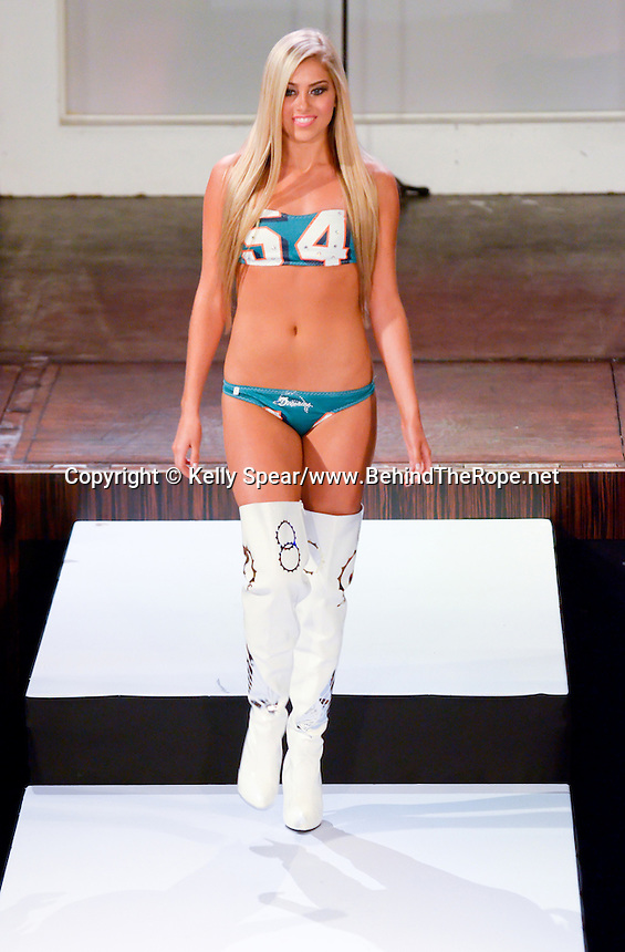 Miami Dolphins Cheerleader walks runway at Miami Dolphins Cheerleaders 2013 Swimsuit Calendar Unveiling Fashion Show at LIV Nightclub in The Fontainebleau Miami Beach Hotel, Miami Beach, FL on August 26, 2012