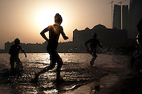 13 MAR 2010 - ABU DHABI, UAE - Elite competitors leave the water at the end of the first lap of the 3km swim during the Abu Dhabi International Triathlon (PHOTO (C) NIGEL FARROW)