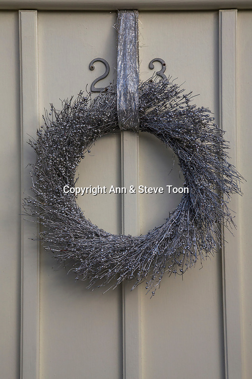 Christmas wreath, hanging on door, Corbridge, Northumberland, UK, December 2017