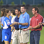 Mia Hamm and her three coaches, Tony DiCicco, Anson Dorrance, and Jim Gabarra, at SAS Stadium in Cary, North Carolina on 6/18/03 during the 2003 WUSA All Star Skills Competition.