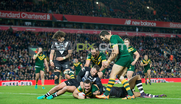 Picture by Allan McKenzie/SWpix.com - 20/11/2016 - Rugby League - 2016 Ladbrokes Four Nations Final - Australia v New Zealand - Anfield, Liverpool, England - New Zealand's Lewis Brown is unable to prevent Australia's Boyd Cordner from scoring a try and sealing the 4 Nations Final.
