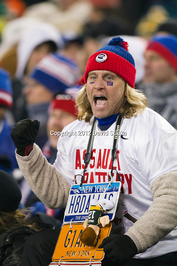 New York Giants fan celebrates a touchdown during an NFL divisional playoff football game against the Green Bay Packers on January 15, 2012 in Green Bay, Wisconsin. The Giants won 37-20. (AP Photo/David Stluka)