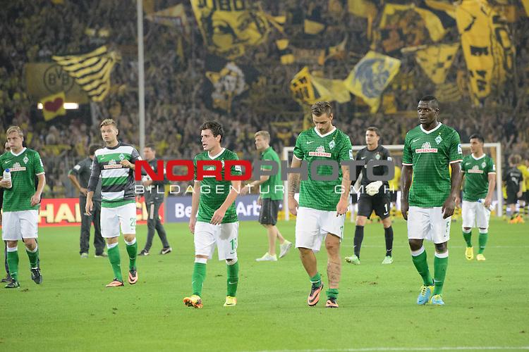23.08.2013, Signal Iduna Park, Dortmund, GER, 1.FBL, Borussia Dortmund vs Werder Bremen, im Bild<br /> Entaeuschung, NIederlage, gestik, Mimik,<br /> Zlatko Junuzovic (Bremen #16)  Marko Arnautovic (Bremen #7) Assani Lukimya (Bremen #5)<br /> <br /> Foto &copy; nph / Kokenge