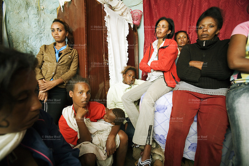 Eritrea. Maekel province. Asmara. Behavioural Change Communication (BCC) for Commercial Sex Workers (CSW). A group of prostitute meet in a small room and talk about HIV Aids prevention. All black women, some with children. The Global Fund through the eritrean Ministry of Health supports the programm with a Aids grant (financial aid).   © 2006 Didier Ruef