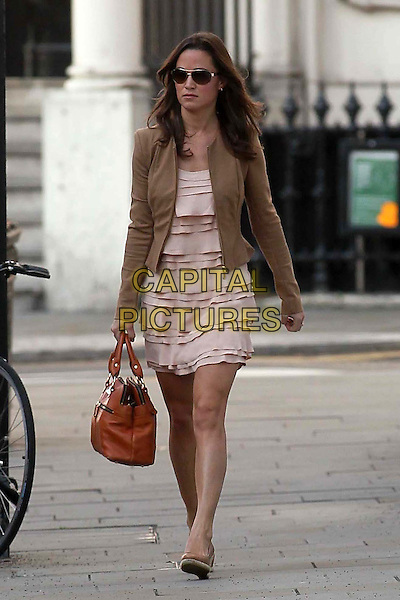 Pippa Middleton on her way to work,.London, England..28th September 2011.full length sunglasses shades pink dress layered layers beige blazer bag purse brown jacket.CAP/HIL.©John Hillcoat/Capital Pictures .