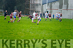 St Mary's Conor O'Shea shrugs off the challenge from Dromids Gearoid O'Sullivan.