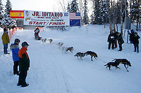 Sunday February 27, 2010   Yuta Takagi leaves the start line of the Junior Iditarod at Willow Lake , Alaska