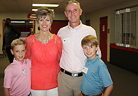 NWA Democrat-Gazette/CARIN SCHOPPMEYER Susan and Jack O'Keefe, Hall of Honor inductee, and their sons Hogan (left) and Henry enjoy the VIP reception Sept. 7.