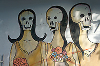Mural depicting women with skull faces on a wall in in downtown, Cancun, Quintana Roo, Mexico.