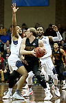 SIOUX FALLS, SD - MARCH 22: Darryl White #25 and Daniel Carr #1 from Queens (NC) double team Darin Peterka #22 from Northern State during their semifinal game at the 2018 Elite Eight Men's NCAA DII Basketball Championship at the Sanford Pentagon in Sioux Falls, SD. (Photo by Dave Eggen/Inertia)