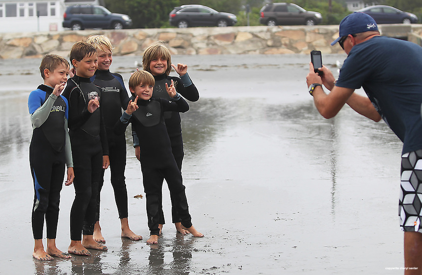 Little surfers get together for a group picture, from left, Atticus Roop, 9, of Kennebunkport, Aiden Mahoney, 9, of Kennebunkport, Quin Battagliese, 9, of Kennebunkport, Evan Anastas, 5, of York and brother Jake Anastas, 8, of York, during the Big Andrew Surf Competition in York, ME., Sunday, Aug. 12, 2012. (Portsmouth Herald Photo Cheryl Senter)