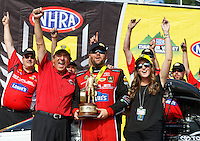 Jun 19, 2016; Bristol, TN, USA; NHRA top fuel driver Shawn Langdon (center) celebrates with team owner Don Schumacher (left) and his daughter Megan Schumacher after winning the Thunder Valley Nationals at Bristol Dragway. Mandatory Credit: Mark J. Rebilas-USA TODAY Sports
