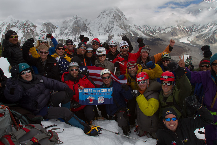 Soldiers to the Summit team photo on summit of Lobuche at 20,075 feet. Mt Pumori and Everest base camp are in the background Photo by Didrik Johnck.