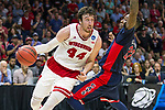 Wisconsin Badgers center Frank Kaminsky (44) drives to the basket during a college basketball Elite 8 West Regional game in the NCAA Tournament against the Arizona Wildcats Thursday, March 28, 2015, in Los Angeles.The Badgers won 85-78. (Photo by David Stluka)