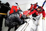 15 December 2007: A forerunner pilot sled overturns prior to the first run of the FIBT World Cup Women's Bobsled Competition at the Olympic Sports Complex on Mount Van Hoevenberg, at Lake Placid, New York, USA. The pilot sled athletes were helped out of the track by operations personnel and were not injured...Mandatory Photo Credit: Ed Wolfstein Photo