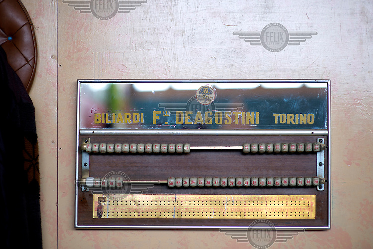 An original scoreboard, made in Turin, used during a game of billards inside the Multi Sport Club where they play a form of five-pin billiards, originally an Italian billiards game.