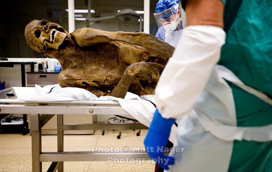 The corpse of a presumed migrant found on the Tohono O'odham reservation near Cockleburr Village on August 2,2009 rests on an autopsy table for an examination at the Pima County Medical Examiners office in Tucson, Arizona, Wednesday, August 5, 2009. The person is thought to be a man and an identification card was found 30 feet from the body which might be his. ..PHOTOS/ MATT NAGER