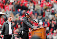 "Quarterback Braxton Miller pauses as the crowd chants ""One more year"" during the Ohio State football National Championship celebration at Ohio Stadium on Saturday, January 24, 2015. Head coach Urban Meyer is at left. (Columbus Dispatch photo by Jonathan Quilter)"