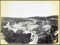 BNPS.co.uk (01202 558833)<br /> Pic: Nosb&uuml;sch&amp;Stucke/BNPS<br /> <br /> The Zigzag railway, New South Wales.<br /> <br /> A stunning collection of photographs of Sydney decades before the iconic harbour bridge and opera house were built has been unearthed after 129 years.<br /> <br /> The black and white photo album captures the bustling city centre, picturesque main harbour and famous beaches of the future tourist hot-spot. <br /> <br /> The photos were taken by celebrated Australian photographer Henry King in 1888 who was born in England but emigrated to Australia at a young age and spent the rest of his life there.<br /> <br /> More recently they have fallen into the hands of a German collector who has decided to put them on the market and they are tipped to sell for &pound;1,800.<br /> <br /> Many of Sydney's most recognisable landmarks including Manly beach and Coogee bay look very different to what backpackers would encounter today.<br /> <br /> King also took various photos of Circular Quay - the city's main harbour - but missing from them are images of the Sydney Harbour Bridge and Sydney Opera House as these landmarks were both not built until well into the 20th century.