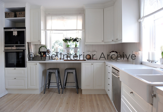The design of the kitchen is original but the family has changed all the fittings, doors, work surfaces and sink to create this contemporary, light and airy space