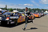Aug. 7, 2009; Watkins Glen, NY, USA; NASCAR Sprint Cup Series driver Carl Edwards runs to his car prior to the start of practice for the Heluva Good at the Glen. Mandatory Credit: Mark J. Rebilas-