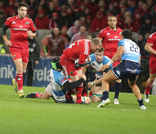 14.11.2015.  Thomond Park, Limerick, Ireland. European Rugby Champions Cup. Munster versus Benetton Treviso. Munster's Keith Earls is held up.