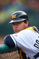Montgomery Biscuits catcher Wilmer Dominguez in the dugout during a game against the Jackson Generals on April 29, 2015 at Riverwalk Stadium in Montgomery, Alabama.  Jackson defeated Montgomery 4-3.  (Mike Janes/Four Seam Images)