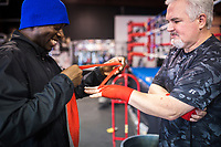 NWA Democrat-Gazette/CHARLIE KAIJO Coach Bernard Oliver puts wraps on Grant Weatherill of Rogers  during a boxing class, Monday, June 11, 2018 at  Straightright Boxing and Fitness in Springdale.<br />