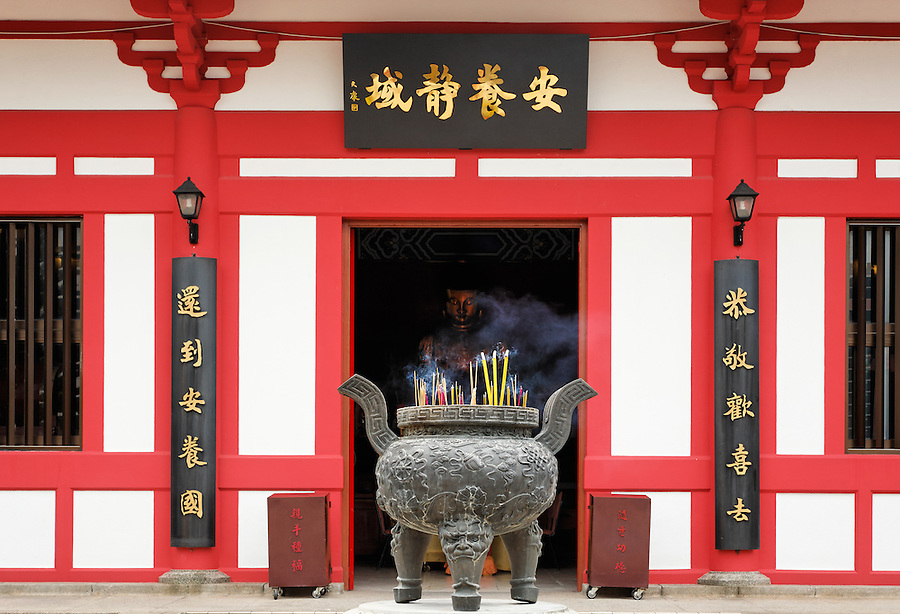 Incense burning in cauldron outside Buddhist temple in Po Fook Hill Cemetery, Sha Tin, New Territories, Hong Kong SAR, People's Republic of China, Asia