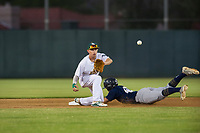 AZL Athletics shortstop Nick Allen (2) waits for a throw from the catcher as Robert Henry (49) steals second base during a game against the AZL Brewers on August 18, 2017 at Lew Wolff Training Complex in Mesa, Arizona. AZL Brewers defeated the AZL Athletics 6-4. (Zachary Lucy/Four Seam Images)