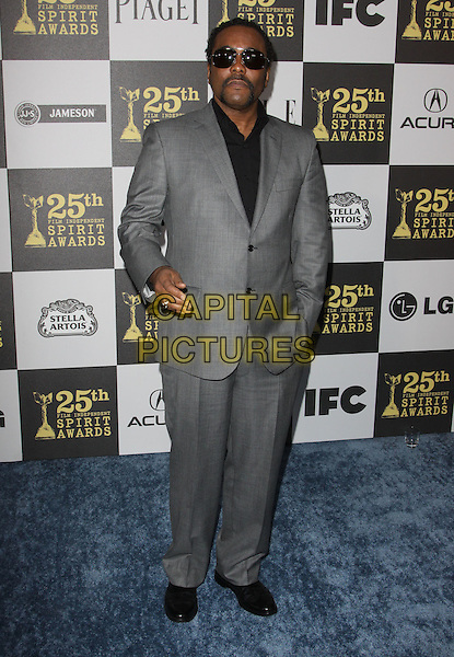 LEE DANIELS.25th Annual Film Independent Spirit Awards held At The Nokia LA Live, Los Angeles, California, USA,.March 5th, 2010 ..arrivals Indie Spirit full length black suit  grey gray sunglasses hand in pocket .CAP/ADM/KB.©Kevan Brooks/Admedia/Capital Pictures