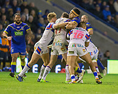 23rd March 2018, Halliwell Jones Stadium, Warrington, England; Betfred Super League rugby, Warrington Wolves versus Wakefield Trinity; Sitaleki Akauola surrounded by Wakefield tacklers including Tinirau Arona (r) and Matty Ashurst (c)
