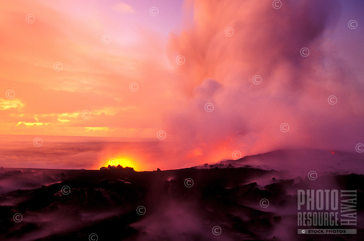 Steam rises above the black lava fields on the march to the sea.