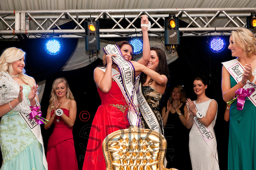 The moment of glory - winner of Miss Mansfield 2012-13 Alice Kurylo receives her sash from last year's winner Alicia Caley.