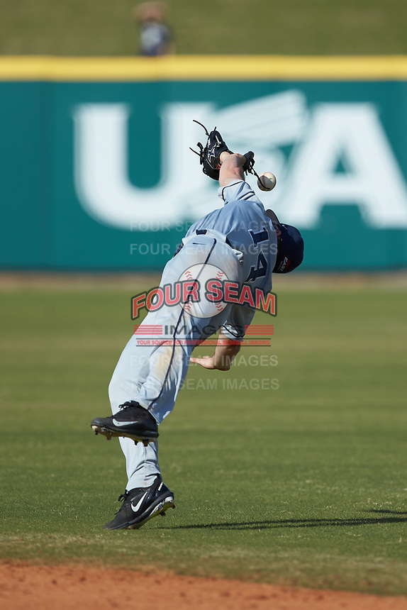 Sam Flamini (14) of the Xavier Musketeers attempts to catch a ball against the Penn State Nittany Lions at Coleman Field at the USA Baseball National Training Center on February 25, 2017 in Cary, North Carolina. The Musketeers defeated the Nittany Lions 10-4 in game one of a double header. (Brian Westerholt/Four Seam Images)