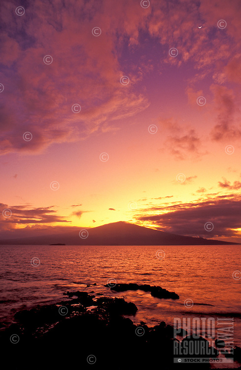 Sunrise at Haleakala, Maui as seen from the island of Kahoolawe