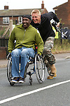 Pix: Shaun Flannery/sf-pictures.com..COPYRIGHT PICTURE>>SHAUN FLANNERY>01302-570814>>07778315553>>..19th July 2009...........Coalfields Regeneration Trust (CRT) - Street Athletics, Lister Close, Featherstone..Linford Christie in wheelchair race.
