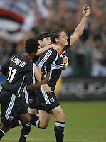 DC United forward Rod Dyachenko (15) celebrates with teammates after scoring the only goal of the game in the 12th minute of play. DC United defeated Club America 1-0 to secure one of the two semifinal berths in SuperLiga group B, at RFK Stadium in Washington DC, Sunday July 29, 2007.