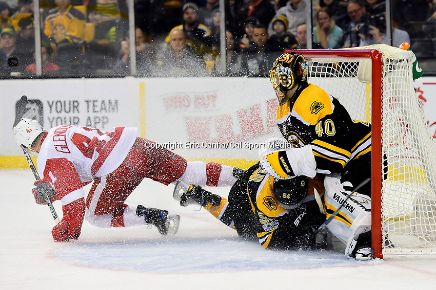 Tuesday, January 24, 2017: Boston Bruins defenseman Adam McQuaid (54) slides into goalie Tuukka Rask (40) during the National Hockey League game between the Detroit Red Wings and the Boston Bruins held at TD Garden, in Boston, Mass. Boston defeats Detroit 4-3 in overtime. Eric Canha/CSM