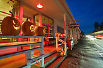 Vashon Island, WA<br /> Large collection of Jack O' Lanterns at dusk on Halloween night on the porch of the Roasterie cafe