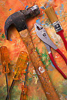 Hammer and tools on painters drop cloth