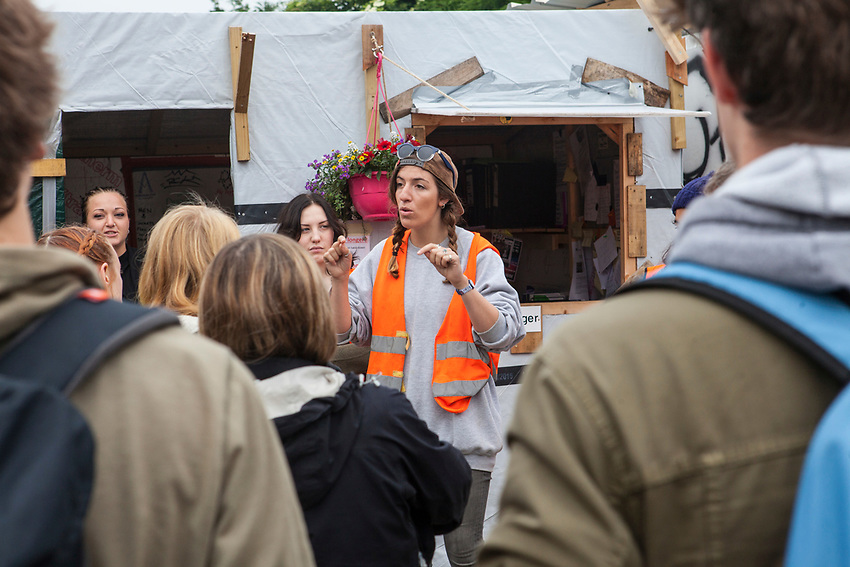 Cecile Burton talks to new volunteers about the rules of Help Refugees UK at the rgansation's wareouses in Calais.  Help Refugees has grown out of #helpcalais, a social media campaign started by Lliana Bird (Radio X DJ), Dawn O'Porter (Writer and Presenter), Josie Naughton and Heydon Prowse (The Revolution will be Televised) to raise a few funds and collect goods to take to Calais to help in some small way. The public response to the campaign was huge, and we were quickly able to provide aid in Calais and far beyond.