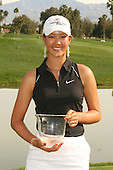 March 27, 2005; Rancho Mirage, CA, USA;  15 year old amateur Michelle Wie Michelle Wie poses with her trophy for low amateur for the tournament at the LPGA Kraft Nabisco golf tournament held at Mission Hills Country Club.  Wie shot a 1 under par 71 for the day and an even par 288 for the tournament and finished tied for 14th overall.<br />
