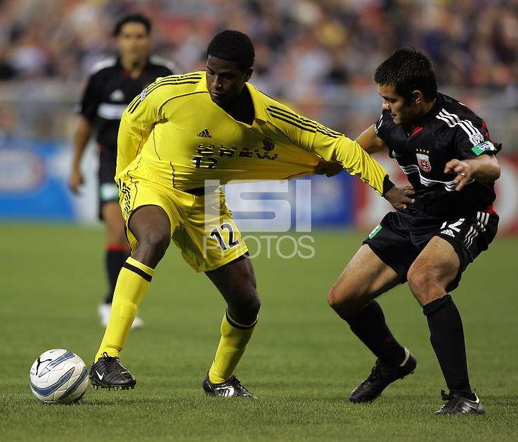 7 May 2005.  Mike Petke (12) of DC United and Columbus Crew forward Edson Buddle (12) fight for control of the ball at RFK Stadium in Washington, DC.