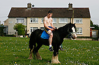 A youth is pictured with his pony on a sunny day in the suburb of Finglas, Dublin, Ireland.<br />