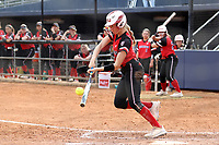GREENSBORO, NC - MARCH 11: Kara Apato #16 of Northern Illinois University hits the ball during a game between Northern Illinois and UNC Greensboro at UNCG Softball Stadium on March 11, 2020 in Greensboro, North Carolina.
