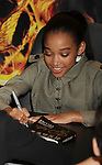 LOS ANGELES, CA - MARCH 22: Amandla Stenberg of Lionsgate's 'The Hunger Games' pose at Barnes & Noble at The Grove on March 22, 2012 in Los Angeles, California.