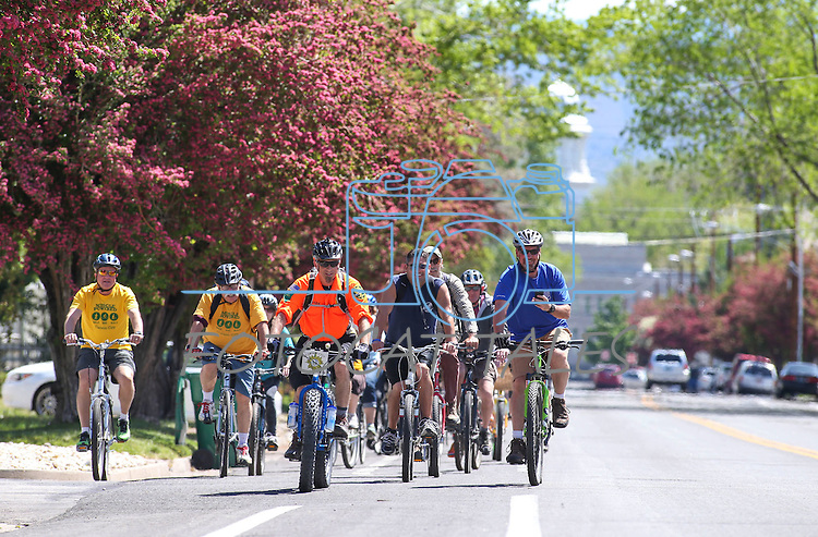 Riders cruise up King Street during the annual Carson City Celebrity Ride in Carson City, Nev., on Monday, May 4, 2015. The mayor, city supervisors and other community leaders ride to kick off month-long Bike Month events. <br /> Photo by Cathleen Allison