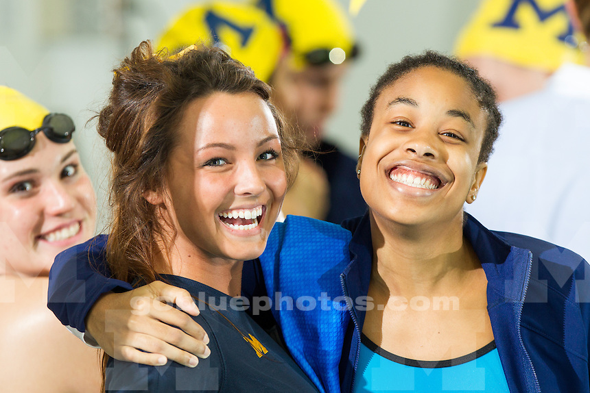 The University of Michigan women's swimming and diving team won 13 of 16 events in a 185-111 victory over Iowa today at Canham Natatorium in Ann Arbor, Mich.