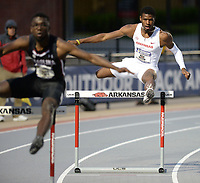 NWA Democrat-Gazette/ANDY SHUPE<br /> Arkansas' Nick Hilson (right) competes Thursday, May 9, 2019, in the 400-meter hurdles during the SEC Outdoor Track and Field Championships at John McDonnell Field in Fayetteville. Visit nwadg.com/photos to see more photographs from the meet.
